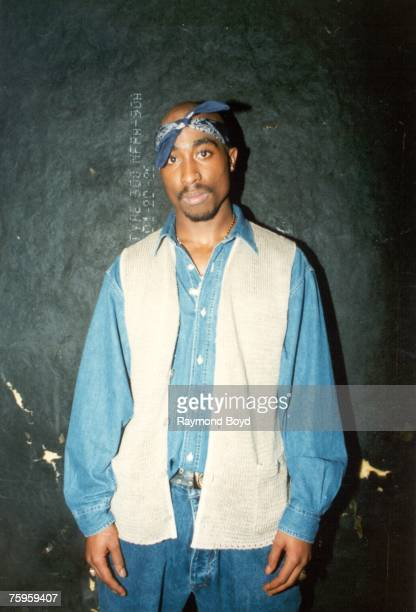 Rapper Tupac Shakur poses for photos backstage after his performance at the Regal Theater in Chicago Illinois in March 1994