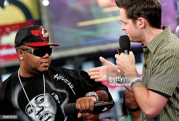 Rapper Twista shows off his bling with VJ Damien Fahey as he stops by MTV's Total Request Live October 4 2005 in New York City