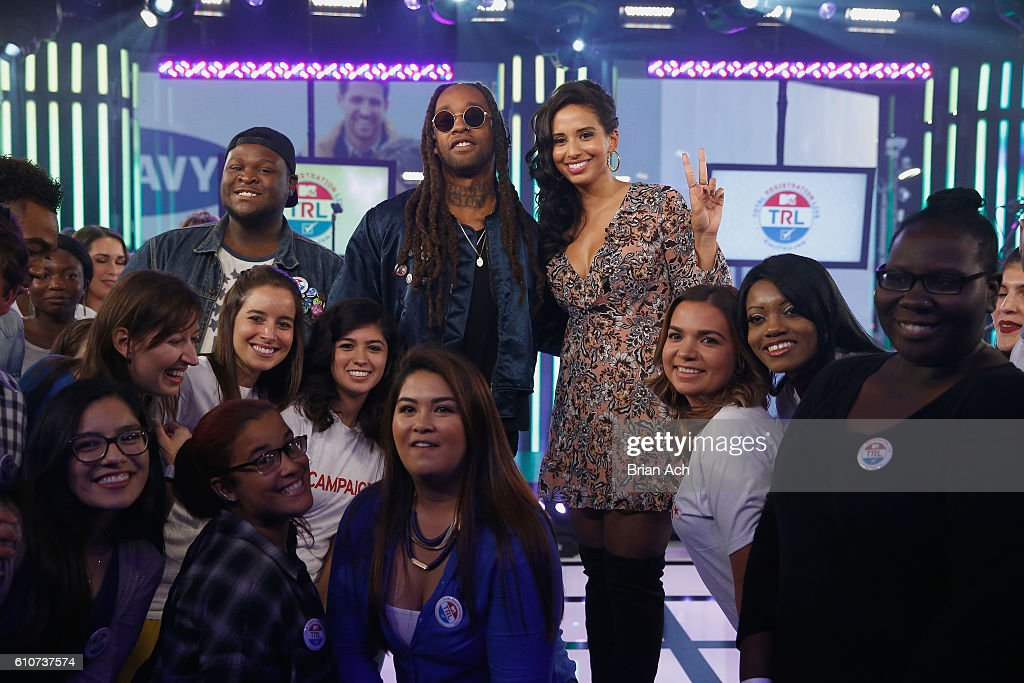 Rapper Ty Dolla Sign (L) and host Nessa pose with the audience during on MTV Total Registration Live at MTV Studios on September 27, 2016 in New York City.