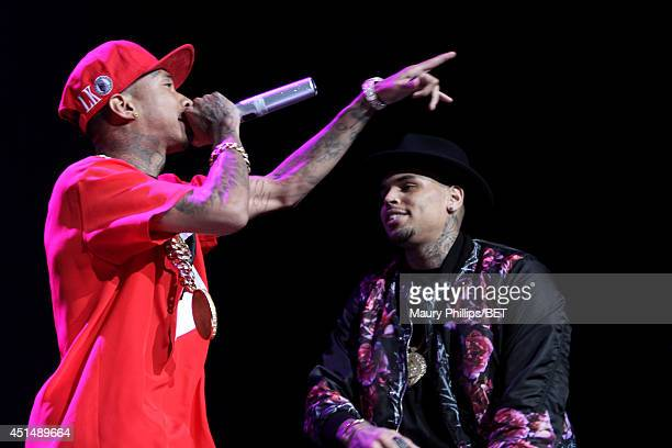 Rapper Tyga and recording artist Chris Brown perform onstage at the Mary J Blige Trey Songz And Jennifer Hudson Concert Presented By Kingcom during...