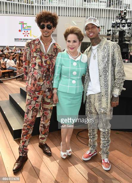 Rapper Tyga Dewi Sukarno and guest are seen at Roppongi Hills arena on June 10 2017 in Tokyo Japan