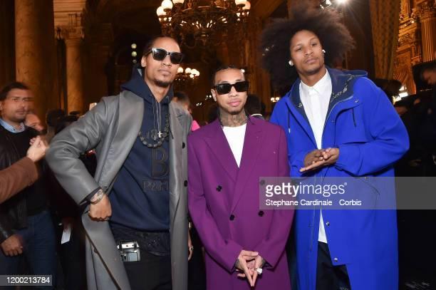 Rapper Tyga standing between Les Twins Larry Bourgeois aka Ca Blaze and Laurent Bourgeois aka Lil Beast attend the Berluti Menswear Fall/Winter...