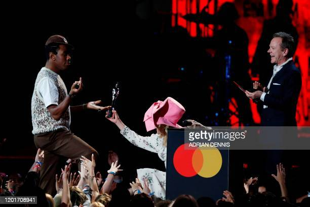US rapper Tyler the Creator collects his award for International Male Solo Artist from British singersongwriter Paloma Faith and Canadian actor...