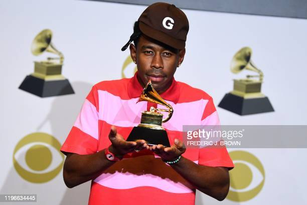 US rapper Tyler the Creator poses in the press room with the award for Best Rap Album for Igor during the 62nd Annual Grammy Awards on January 26 in...