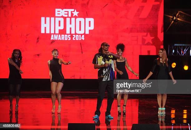 Rapper Uncle Snoop performs onstage during the BET Hip Hop Awards 2014 at Boisfeuillet Jones Atlanta Civic Center on September 20, 2014 in Atlanta,...