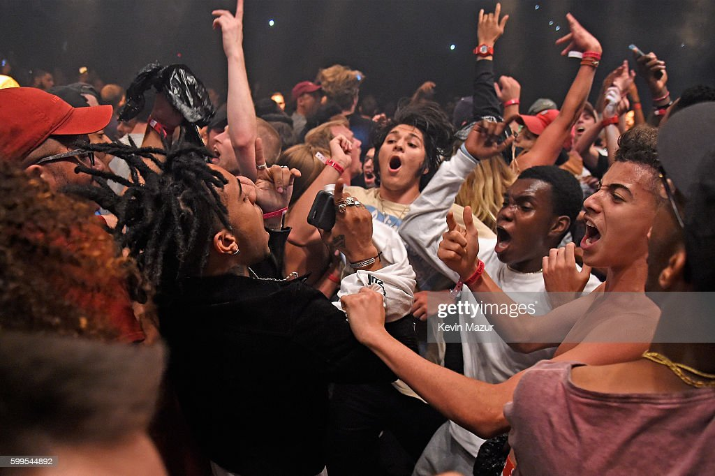 Rapper Vic Mensa (C) Moshes In The Crowd During Kanye West: The Saint