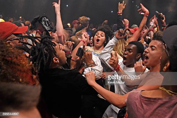Rapper Vic Mensa moshes in the crowd during Kanye West The Saint Pablo Tour at Madison Square Garden on September 5 2016 in New York City