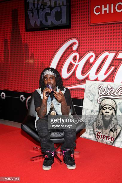 Rapper Wale is interviewed and answers questions from radio station listeners during his visit to the WGCIFM 'CocaCola Lounge' in Chicago Illinois on...