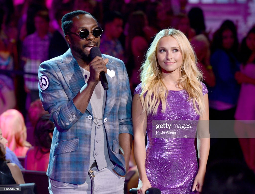 Rapper will.i.am (L) and actress Hayden Panettiere speak onstage during the 2012 Teen Choice Awards at Gibson Amphitheatre on July 22, 2012 in Universal City, California.