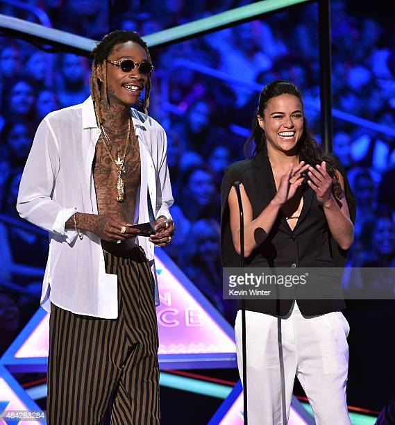 Rapper Wiz Khalifa and actress Michelle Rodriguez speak onstage during the Teen Choice Awards 2015 at the USC Galen Center on August 16 2015 in Los...