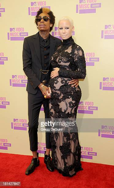 Rapper Wiz Khalifa and Amber Rose arrive at 2012 MTV Video Awards at Staples Center on September 6, 2012 in Los Angeles, California.