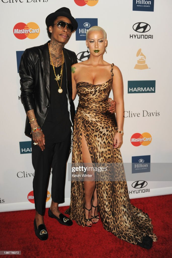 Rapper Wiz Khalifa and Amber Rose arrive at Clive Davis and the Recording Academy's 2012 Pre-GRAMMY Gala and Salute to Industry Icons Honoring Richard Branson held at The Beverly Hilton Hotel on February 11, 2012 in Beverly Hills, California.