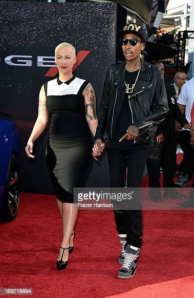 Rapper Wiz Khalifa and Amber Rose arrive at the Premiere Of Universal Pictures' Fast Furious 6 on May 21 2013 in Universal City California