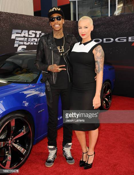 Rapper Wiz Khalifa and Amber Rose attend the premiere of Fast Furious 6 at Universal CityWalk on May 21 2013 in Universal City California