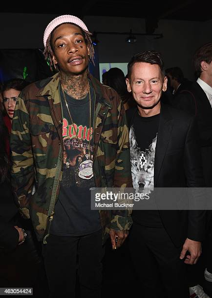Rapper Wiz Khalifa and and GQ EditorinChief Jim Nelson attend GQ and Giorgio Armani Grammys After Party at Hollywood Athletic Club on February 8 2015...