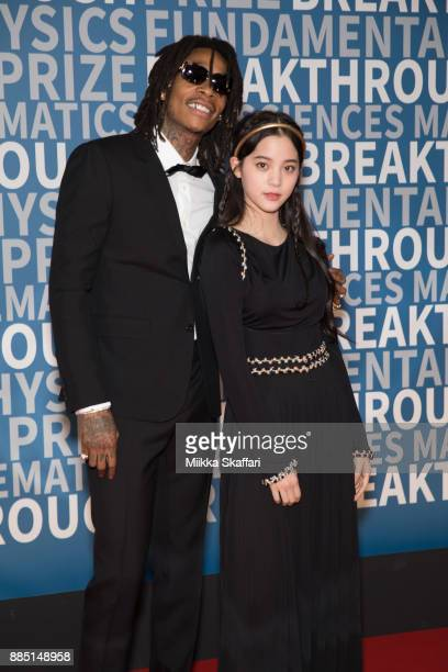 Rapper Wiz Khalifa and cellist Nana OuYang arrive at the 2018 Breakthrough Prize at NASA Ames Research Center on December 3 2017 in Mountain View...