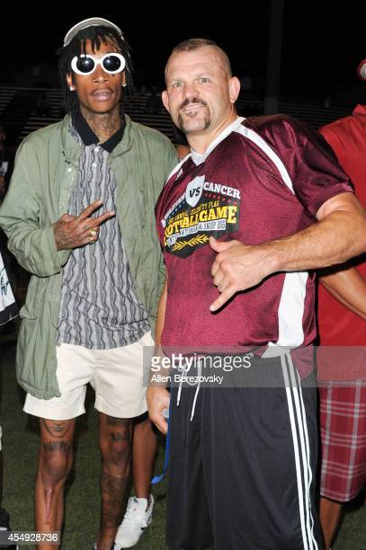 Rapper Wiz Khalifa and MMA fighter Chuck Liddell attend the 2nd Annual Celebrity Flag Football Game benefiting Athletes VS Cancer at Granada Hills...
