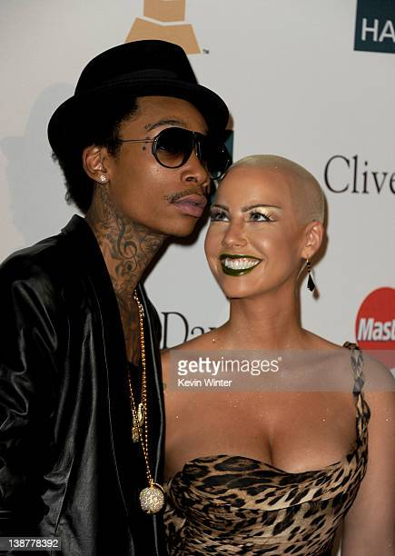 Rapper Wiz Khalifa and model Amber Rose arrive at Clive Davis and the Recording Academy's 2012 PreGRAMMY Gala and Salute to Industry Icons Honoring...
