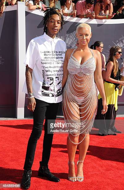 Rapper Wiz Khalifa and Model Amber Rose arrive at the 2014 MTV Video Music Awards at The Forum on August 24 2014 in Inglewood California