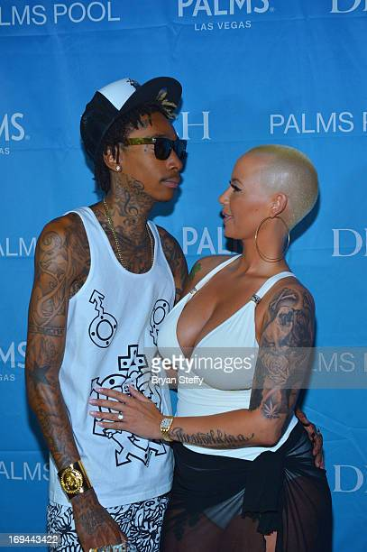 Rapper Wiz Khalifa and model Amber Rose arrive at the Palms Pool Bungalows Ditch Fridays at the Palms Casino Resort on May 24 2013 in Las Vegas Nevada