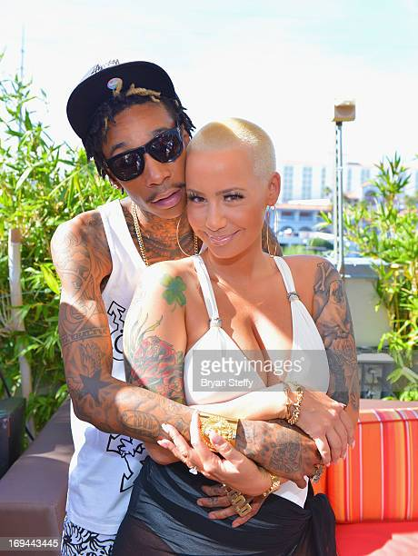 Rapper Wiz Khalifa and model Amber Rose attend Ditch Fridays at the Palms Pool Bungalows at the Palms Casino Resort on May 24 2013 in Las Vegas Nevada