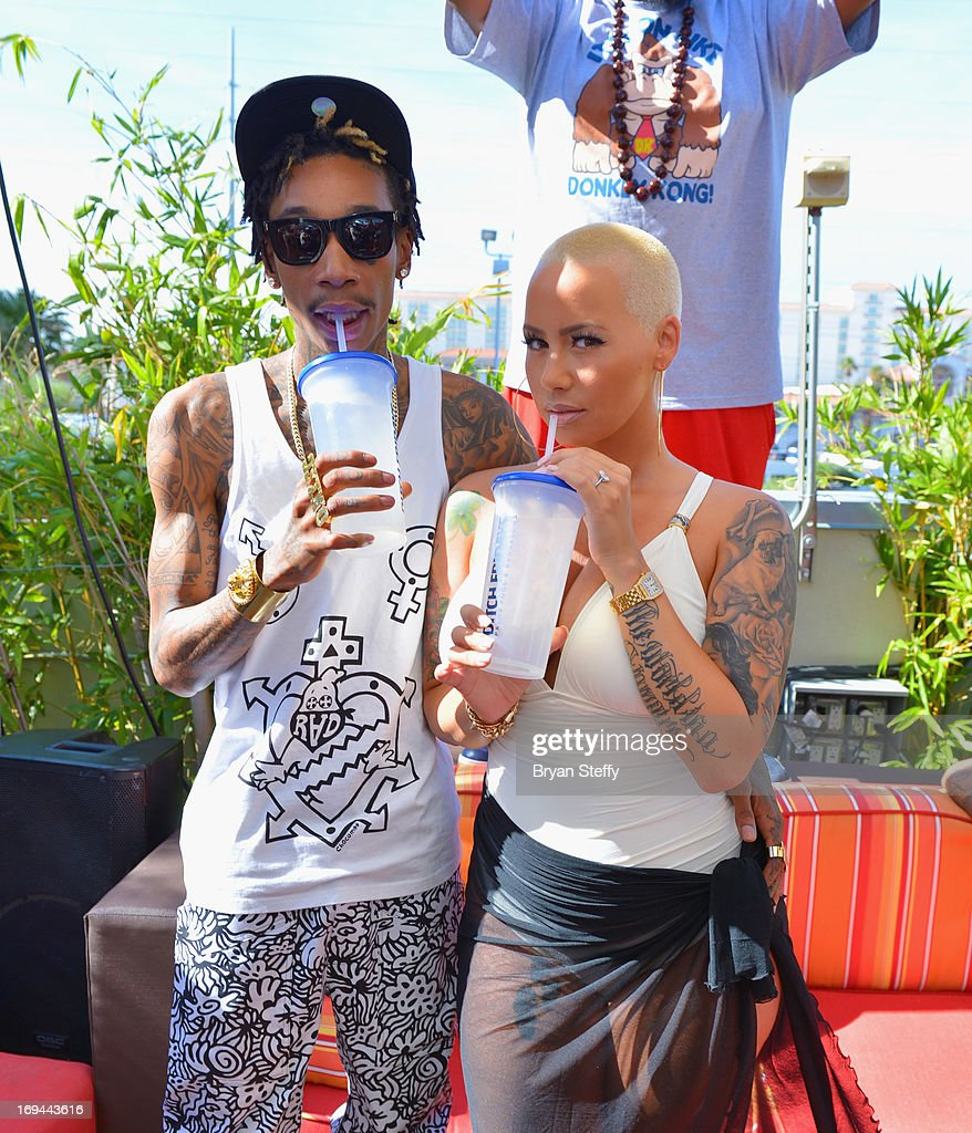 Rapper Wiz Khalifa (L) and model Amber Rose attend Ditch Fridays at the Palms Pool & Bungalows at the Palms Casino Resort on May 24, 2013 in Las Vegas, Nevada.