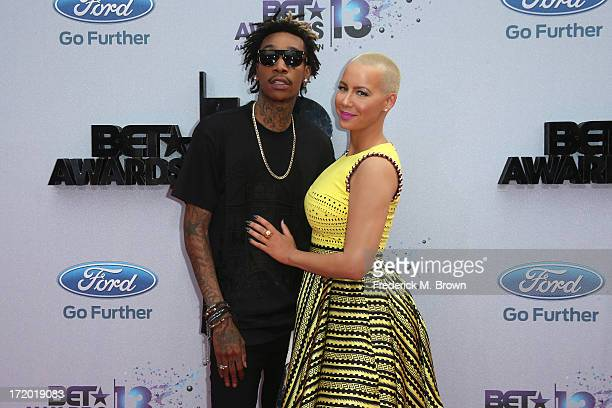 Rapper Wiz Khalifa and model Amber Rose attend the 2013 BET Awards at Nokia Theatre LA Live on June 30 2013 in Los Angeles California