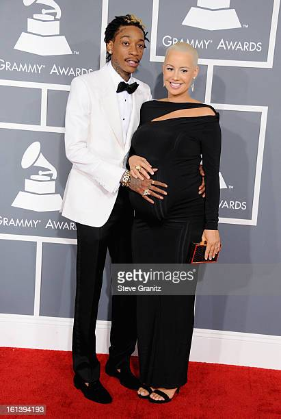 Rapper Wiz Khalifa and model Amber Rose attend the 55th Annual GRAMMY Awards at STAPLES Center on February 10 2013 in Los Angeles California