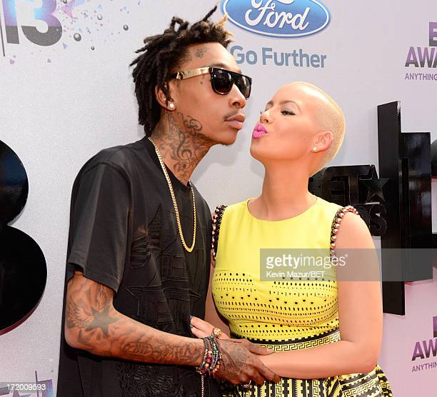 Rapper Wiz Khalifa and model Amber Rose attend the Ford Red Carpet at the 2013 BET Awards at Nokia Theatre LA Live on June 30 2013 in Los Angeles...