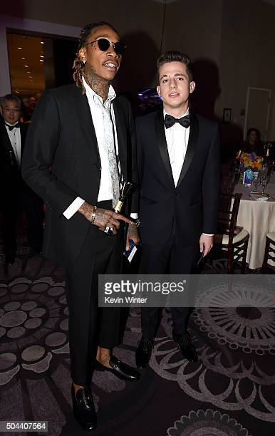 Rapper Wiz Khalifa and singer Charlie Puth attend the cocktail reception during the 73rd Annual Golden Globe Awards at The Beverly Hilton Hotel on...