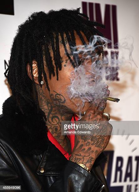 Rapper Wiz Khalifa arrives at the Los Angeles premiere of Jimi All Is By My Side at the ArcLight Cinemas on September 22 2014 in Hollywood California