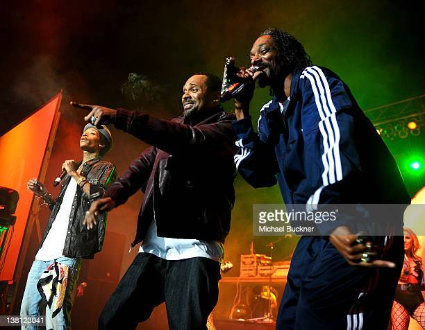 Rapper Wiz Khalifa comedian Mike Epps and rapper Snoop Dogg perform on stage at Bankers Life Fieldhouse on February 2 2012 in Indianapolis Indiana
