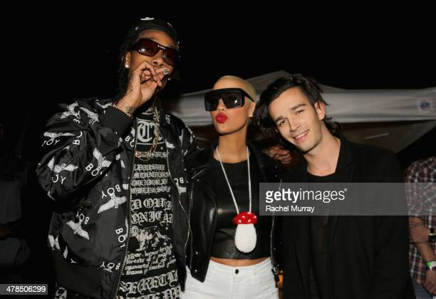 Rapper Wiz Khalifa model Amber Rose and musician Matthew Healy of The 1975 attend the 2014 mtvU Woodie Awards and Festival on March 13 2014 in Austin...