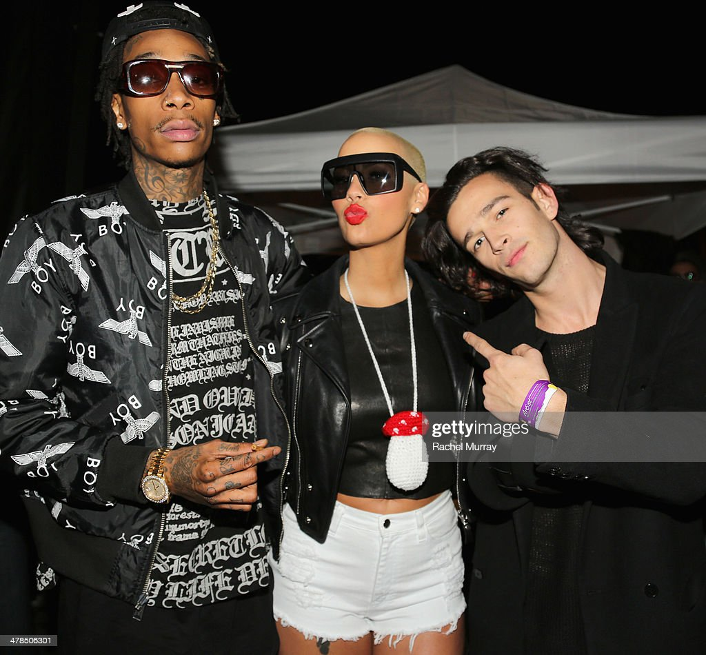 Rapper Wiz Khalifa, model Amber Rose, and musician Matthew Healy, of The 1975, attend the 2014 mtvU Woodie Awards and Festival on March 13, 2014 in Austin, Texas.