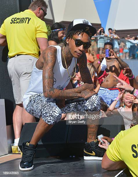 Rapper Wiz Khalifa performs during Ditch Fridays at the Palms Pool Bungalows at the Palms Casino Resort on May 24 2013 in Las Vegas Nevada