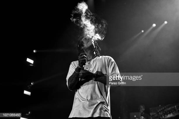 Rapper Wiz Khalifa performs in concert during the 'Dazed Blazed Tour' at Cellairis Amphitheatre at Lakewood on August 21 2018 in Atlanta Georgia
