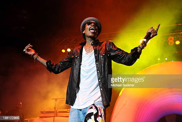 Rapper Wiz Khalifa performs on stage at Bankers Life Fieldhouse on February 2 2012 in Indianapolis Indiana