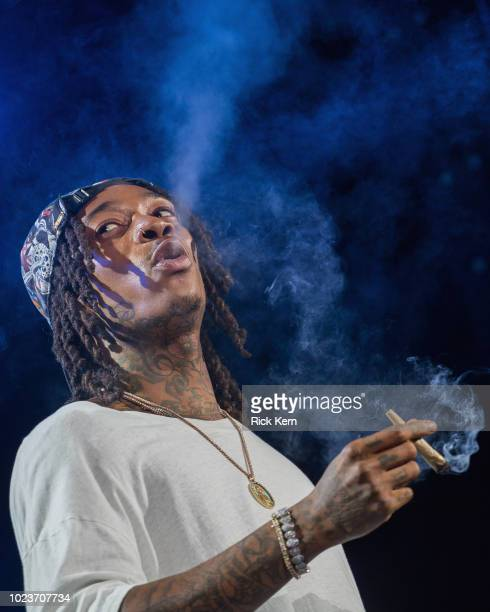 Rapper Wiz Khalifa performs onstage during the 'Dazed Blazed Summer 2018 Tour' at Austin360 Amphitheater on August 25 2018 in Austin Texas