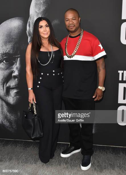 Rapper Xzibit and wife Krista Joiner arrive at the premiere of 'The Defiant Ones' at Paramount Theatre on June 22 2017 in Hollywood California