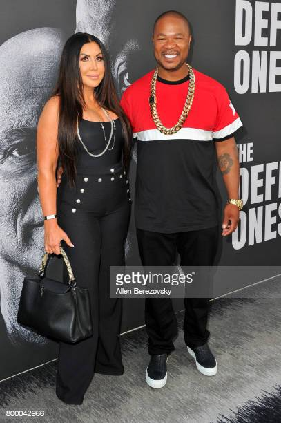 Rapper Xzibit and wife Krista Joiner attend the premiere of HBO's The Defiant Ones at Paramount Theatre on June 22 2017 in Hollywood California