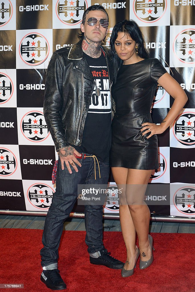 Rapper Yelawolf (L) and Fefe Dobson attend G-Shock - Shock The World 2013 at Basketball City - Pier 36 - South Street on August 7, 2013 in New York City.