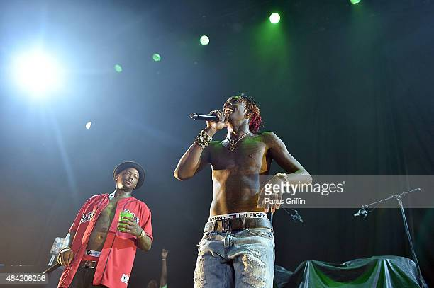 Rapper YG and rapper Rich Homie Quan perform in concert at Aarons Amphitheatre at Lakewood on August 15 2015 in Atlanta Georgia