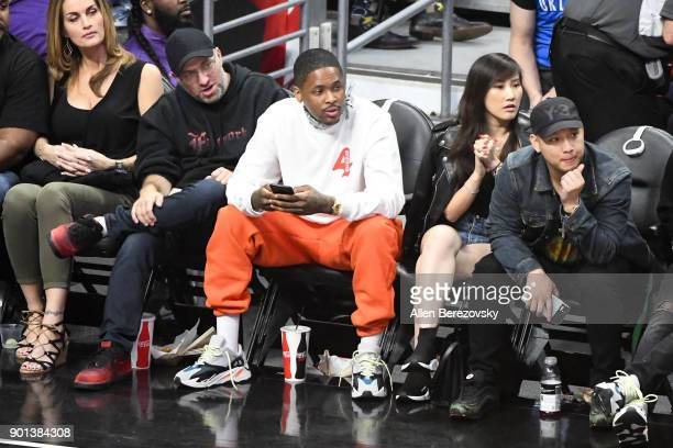 Rapper YG attends a basketball game between the Los Angeles Clippers and the Oklahoma City Thunder at Staples Center on January 4 2018 in Los Angeles...