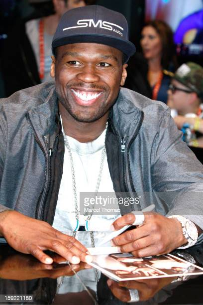 """Rapper/actor Curtis """"50 Cent"""" Jackson attends an autograph signing event at SMS Audio booth during the 2013 International CES held at the Las Vegas..."""