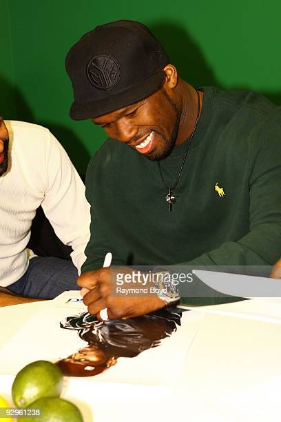 Rapper/actor Curtis '50 Cent' Jackson signs autographs while visiting the WGCIFM 'CocaCola Lounge' in Chicago Illinois on November 09 2009