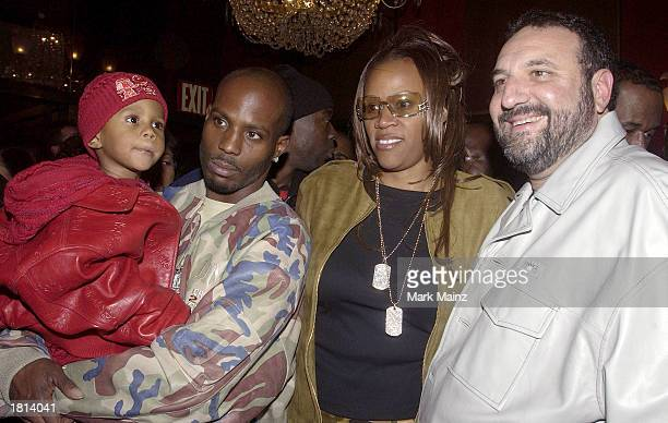 Rapper/actor DMX poses with his family and producer Joel Silver at the Warner Brothers premiere of Cradle 2 the Grave at the Ziegfeld Theater on...