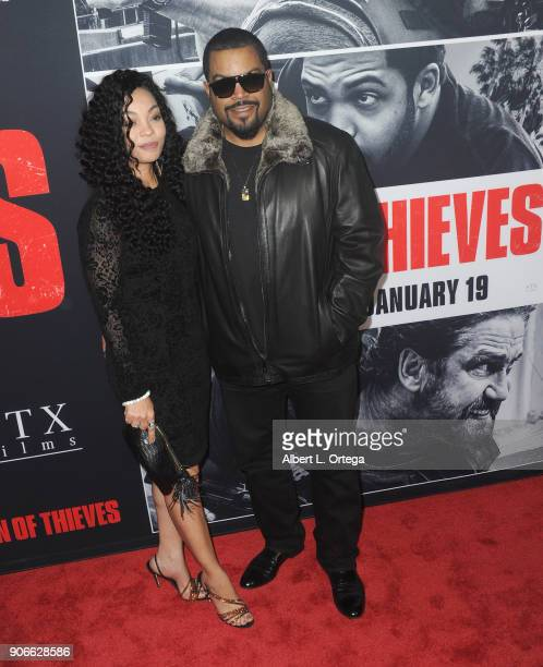 Rapper/actor Ice Cube and wife Kimberly Woodruff arrive for the Premiere Of STX Films' 'Den Of Thieves' held at Regal LA Live Stadium 14 on January...