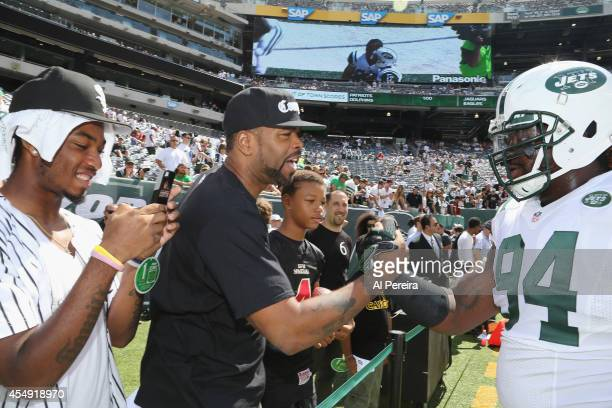 Rapper/actor Method Man meets with Defensive Lineman Damon Harrison of the New York Jets when he attends the New York Jets vs Oakland Raiders game at...