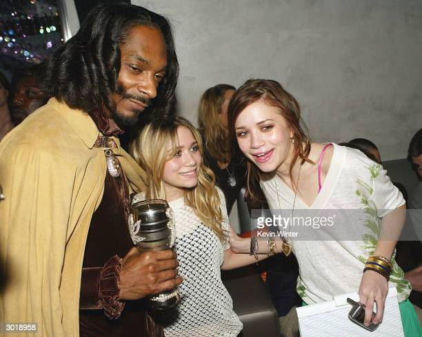 Rapper/actor Snoop Dogg and the Olsen twins MaryKate and Ashley attend the premiere afterparty for Warner Bros 'Starsky and Hutch' at The Factory on...