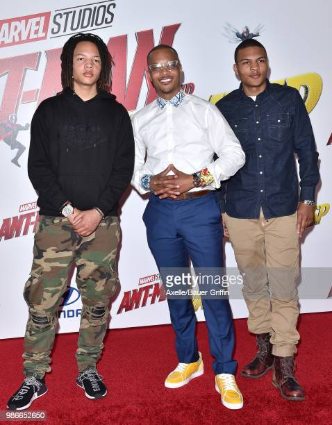 Rapper/actor TI and sons Domani Harris and Messiah Harris attend the premiere of Disney and Marvel's 'AntMan and the Wasp' at El Capitan Theatre on...